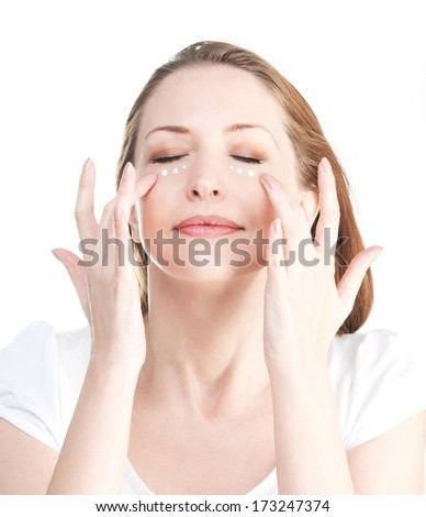 Portrait of woman with massage points isolated on a white backgr - stock photo