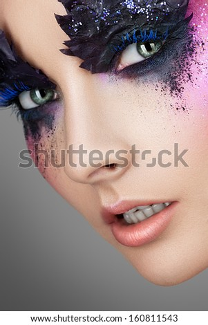 Portrait of woman with red hair and creative make-up ?? ??? Gray background