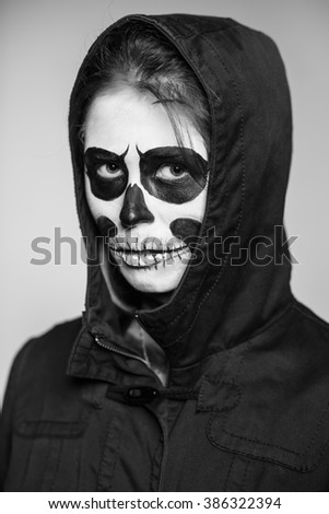 Portrait of woman with scary makeup for Halloween. Monochrome