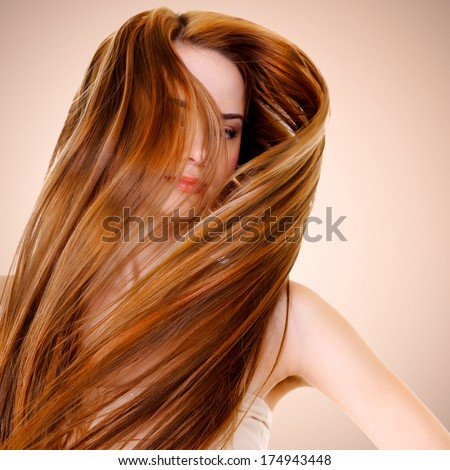 portrait of  woman with  straight long hairs posing at studio - stock photo