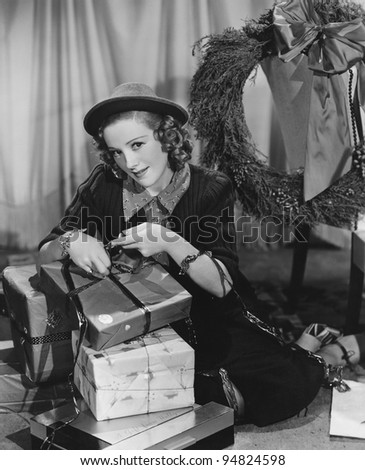 Portrait of woman wrapping Christmas presents