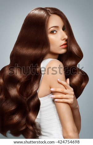 Portrait of wonderful young  woman with long hair looking.Hair cosmetics, haircare.