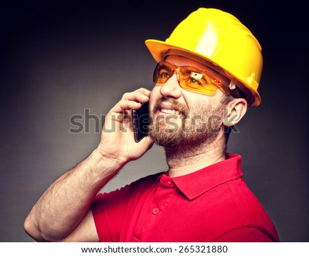 portrait of worker with mobile - stock photo