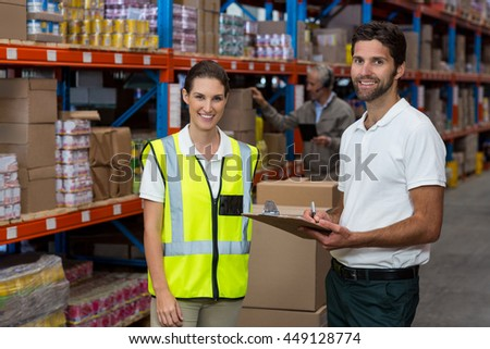 Portrait of workers are smiling and posing face to the camera in a warehouse