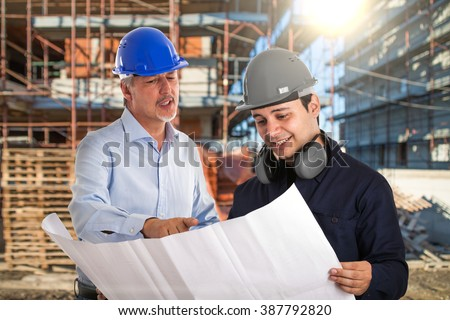 Portrait of workers in a construction site - stock photo