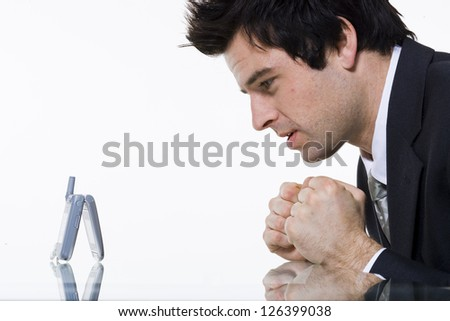 Portrait of worried businessman waiting for call - stock photo