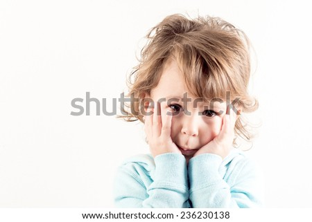Portrait of worried child on white background - stock photo