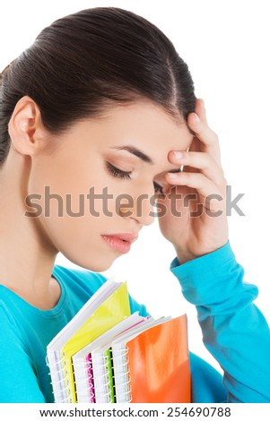 Portrait of worried woman holding her notes.