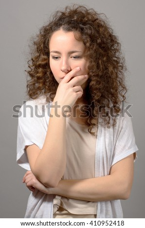 portrait of worried woman on grey background