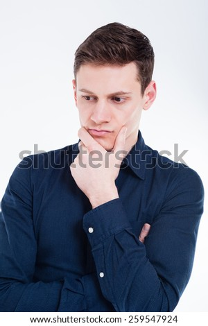 Portrait of worried young businessman - stock photo