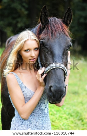 Portrait of yang and pretty female horse rider.