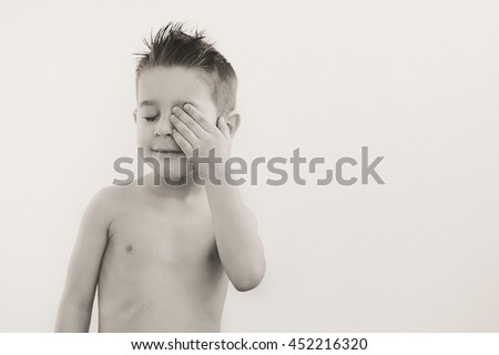 Portrait of 5 year old baby boy on white background. - stock photo