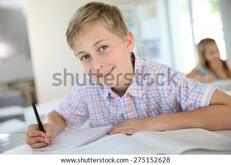 Portrait of 12-year-old boy in classroom - stock photo