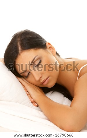 Portrait of 20-25 years old beautiful woman on white bed - stock photo