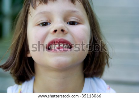 portrait of 5 years old gap toothed girl - stock photo