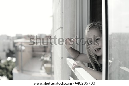 Portrait of 5 years old girl looking to the street