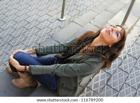 Portrait of 25-years-old girl outdoors - stock photo