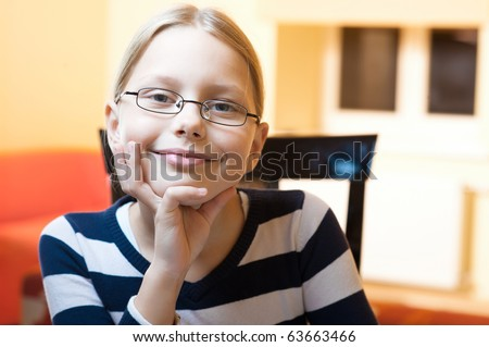 Portrait of 9-10 years old schoolgirl - stock photo