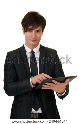 Portrait of you Asian business man holding tablet(not iPad) on white background.