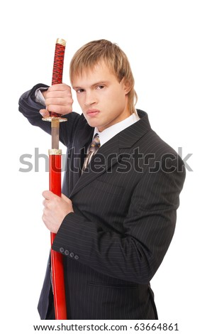 portrait of youn blond man in black suit with katana sword on white - stock photo