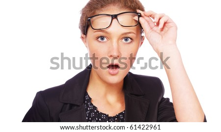 portrait of youn girl in glasses looking shocked - stock photo