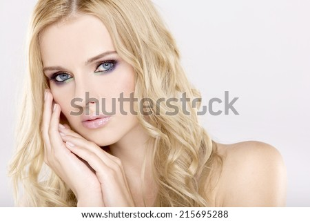 Portrait of young adult pretty and sensuality woman with beautiful blond hairs and multicolor makeup isolated on white background