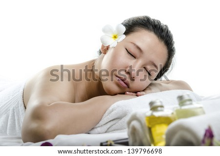 Portrait of young adult relaxing at spa isolated on white - stock photo