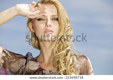 portrait of young adult sensuality and attractive beautiful blonde pretty woman on background blue sky - stock photo