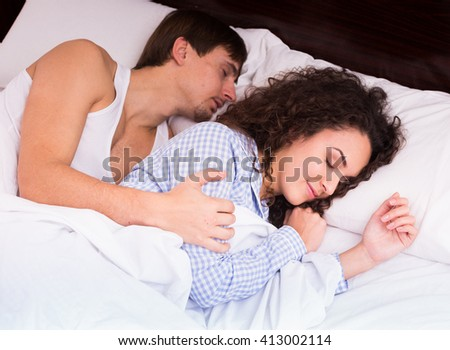 Portrait of young adults hugging each other while sleeping