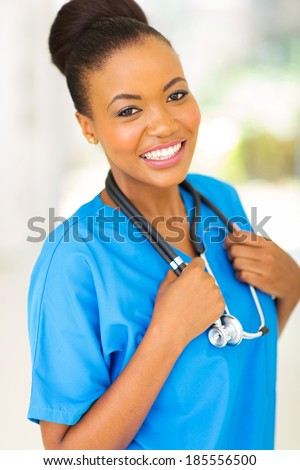 portrait of young africa nurse in hospital - stock photo
