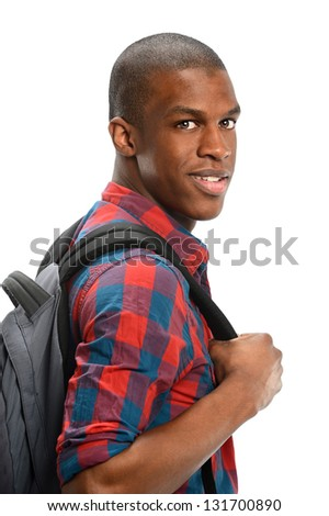 Portrait of young African American man with backpack isolated over white background