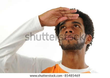 Portrait of young african american man with hand ever the eyes and looking up isolated