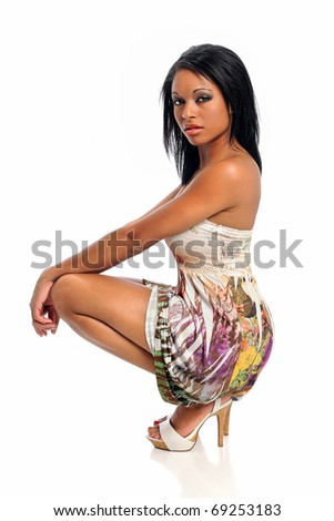 Portrait of young African American woman posing isolated over white background