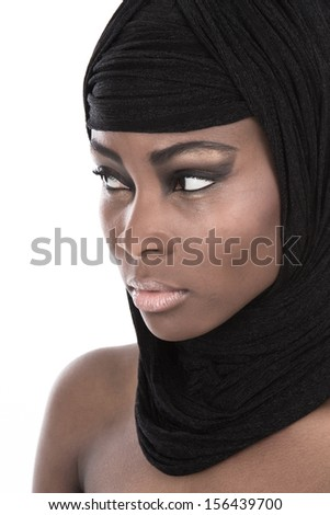 Portrait of young African American woman wearing black shawl - stock photo