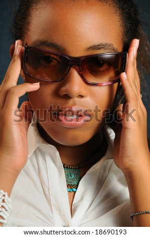 Portrait of young african fashion woman wearing sunglasses - stock photo