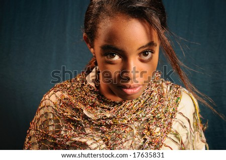 Portrait of young african female model posing - stock photo