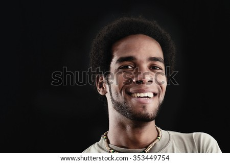 Portrait of young african hispanic man with joyful expression isolated on black