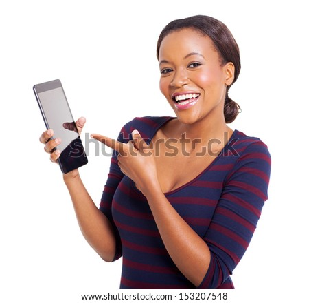 portrait of young african woman pointing at tablet computer isolated on white - stock photo