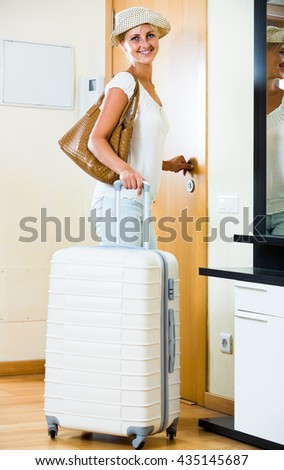 Portrait of young american female traveller going at holiday trip