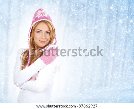 Portrait of young and attractive girl in Christmas style over winter background - stock photo
