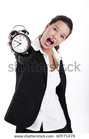 Portrait of Young and beautiful businesswoman holding a clock; focus is on the clock - stock photo