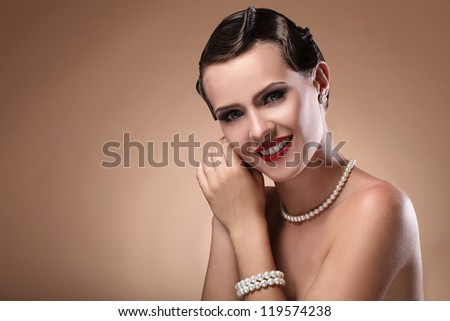 Portrait of young and beautiful smiling woman in vintage image - stock photo