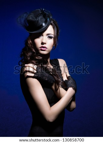 Portrait of young and beautiful woman in retro style - stock photo