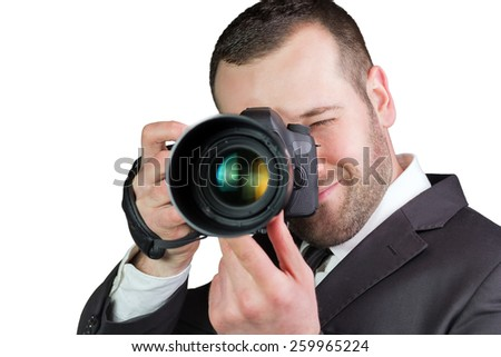 Portrait of young and handsome professional photographer in business suit, isolated on white.