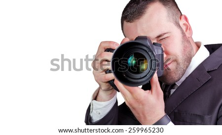 Portrait of young and handsome professional photographer in business suit, isolated on white. - stock photo