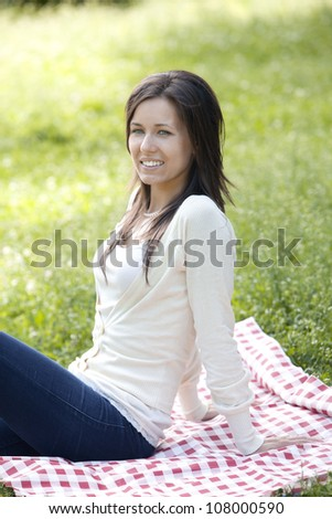 Portrait of young and happy girl in the park