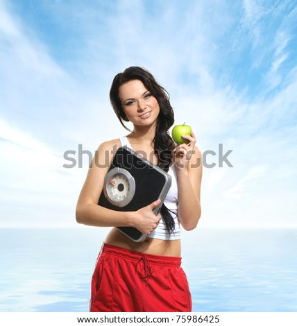 Portrait of young and sexy brunette over natural background - stock photo