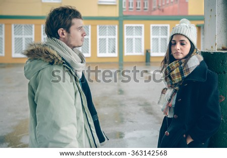 Portrait of young angry couple in disagreement after a quarrel outdoors. Bad relationships and couple problems concept. - stock photo
