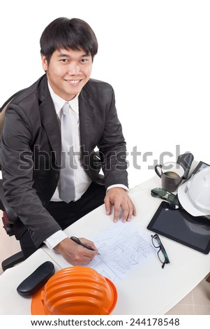 portrait of young architect working drawing perspective building on working table and smiling to camera use for people occupation and construction industry business theme - stock photo