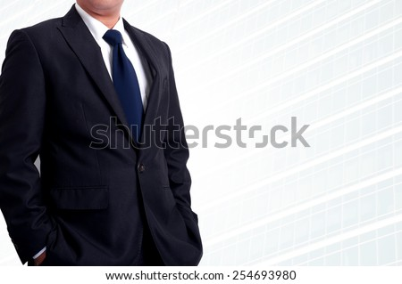 Portrait of young asia business man has office background - stock photo